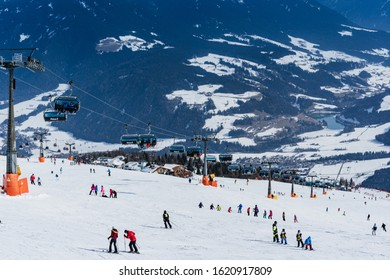 Kronplatz, Italy. - February 19, 2019. Landscape of the ski resort. Lifts and anonymous skiers away on a bright sunny winter day. Winter holidays recreation sport activity. Luxury life.