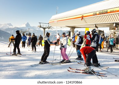 KRONPLATZ, ITALY - FEBRUARY 3: Skiers get ready to cruise down the mountain on February 3, 2012, at the Kronplatz Ski Resort, Italy. Kronplatz is the premier ski resort in South Tyrol.