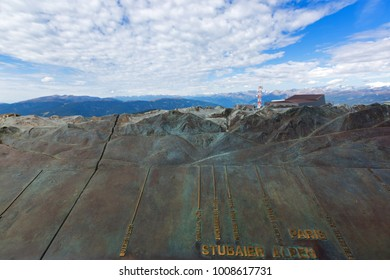 KRONPLATZ, ITALY - SEPTEMBER 2017 : Relief at Concordia 2000 peace viewing platform showing peaks, height visible from Mount Kronplatz, South Tyrol, Italy on September 23, 2017
