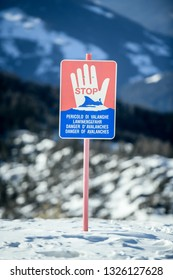 Kronplatz, South Tyrol, Italy - February 15, 2019: Danger of Avalanches warning  sign on snowy mountain slope in Kronplatz Plan de Corones ski resort in the snowy Dolomites on a beautiful sunny day