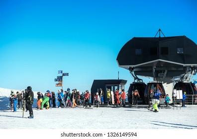 Kronplatz, South Tyrol, Italy - February 15, 2019: people enjoy skiing at Kronplatz Plan de Corones ski resort in the snowy Dolomites on a beautiful sunny day with clear blue sky