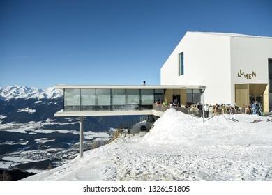 Kronplatz, South Tyrol, Italy - February 15, 2019: LUMEN and  AlpiNN restaurant at Kronplatz - Plan de Corones ski resort in the snowy Dolomites on a beautiful sunny day with clear blue sky