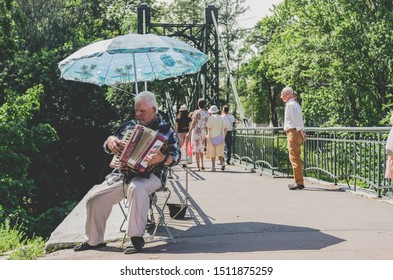 Kronstadt / Russia - 14/07/2018: A man plays the accordion on the street