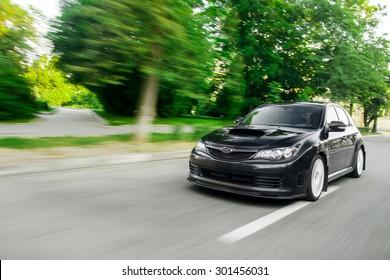 Kronstadt, Russia - June 25, 2013: Car Subaru Impreza WRX STI Fast speed driving on the road at daytime