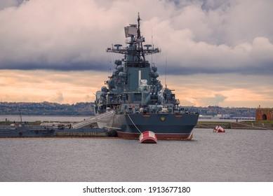 """KRONSTADT, RUSSIA - OCTOBER 06, 2019: Warship-museum  """"Bespokoyny"""" at the berth on a October evening"""
