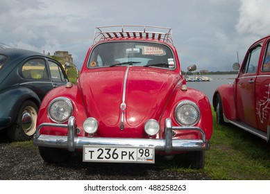 KRONSTADT, RUSSIA - SEPTEMBER 04, 2016: Red Volkswagen Beetle front view. Exhibition and parade of retro cars in Kronstadt