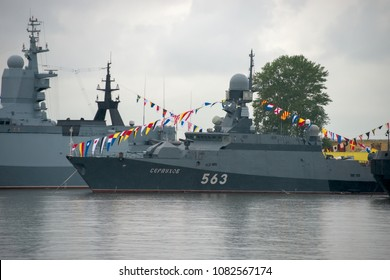 KRONSTADT, SAINT PETERSBURG, RUSSIA - AUGUST 21, 2017: warships docked in Peter the great (middle) harbour