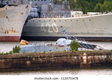 KRONSTADT, ST. PETERSBURG, RUSSIA - JULY 6, 2016: T43 Class (Converted) Seagoing Minesweeper (Project 254) Pennant No. UTS-142 settles in the waters of Kronstadt military seaport on Kotlin Island.