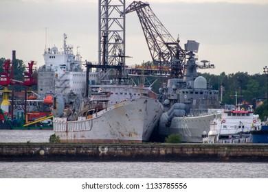 KRONSTADT, ST. PETERSBURG, RUSSIA - JULY 6, 2016: RFS RASTOROPNYY Sovremennyy Class Destroyer Pennant No. 420 (Project 956), moored with RFS KARPATY Rescue-raising Vessel (Project 530), at Kronstadt.