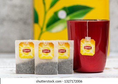 KROPIVNICKY, UKRAINE - JANUARY 11, 2019: Lipton tea in cup and tea bags and box on light background.