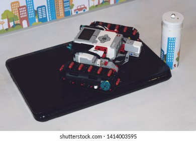 KROPIVNITSKIY, UKRAINE – 12 MAY, 2018: Lego robot Mindstorms EV3 with laptop. Programmable four wheels drive (4WD) robotic car with obstacle avoidance and line follow ability.