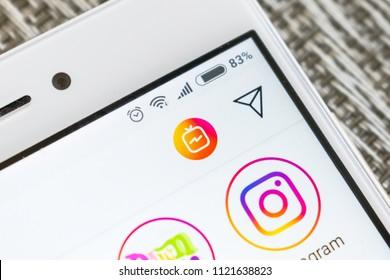 KROPIVNITSKIY, UKRAINE – 23 JUNE, 2018: Smartphone screen with the logo of IGTV instagram close up. New IGTV option in instagram app. Selective focus
