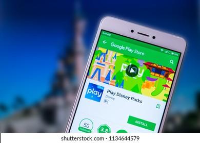 KROPIVNITSKIY, UKRAINE – 8 JULY, 2018: Play Disney Parks new mobile app on smartphone screen. Disneyland Releases New App for Disney Theme Parks
