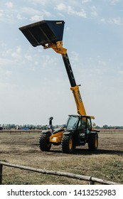 Kropivnitskiy, Ukraine April 20, 2019: The JCB bucket loader, Tractor with bucket raised at a demonstration site agro exhibition AgroExpo