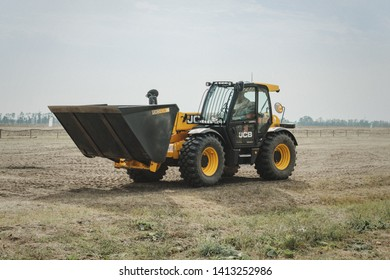 Kropivnitskiy, Ukraine April 20, 2019: The JCB bucket loader, Tractor at a demonstration site agro exhibition AgroExpo. Tractor rides on the field