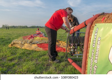 Krosno, Poland, april 30, 2017: XIX-th International Mountains Hot Air Balloons Competition - Team from Budapest Ballon Club during preparation to the evening flight of the 1-st day of competition