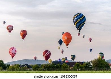 Krosno, Poland, april 30, 2017: XIX-th International Mountains Hot Air Balloons Competition - Mass start et the evening of the 1-st day of competition.