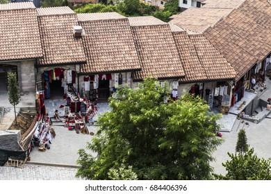 KRUJE, ALBANIA - July 2017: Vintage and souvenir market street in historical town Kruje, Albania