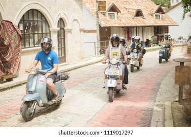 Kruje, Albania - June 2018: Vespa legend team on a trip in Albania riding though old town during tour in Albania..