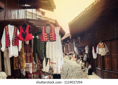 Kruje, Albania - March 2017: Traditional Ottoman market in Kruja, birth town of National Hero Skanderbeg. Flea market in Albania. Antique items and souvenirs for sale.