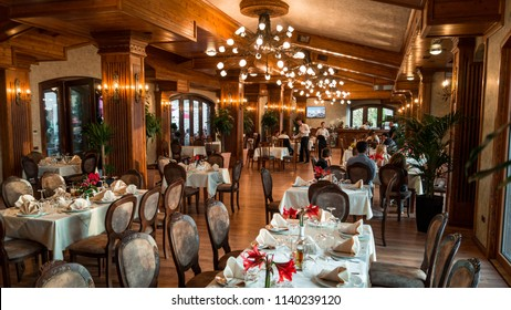 Kruje / Albania - Sunday, May 20, 2018: Restaurant interior . Dinner time during fantastic sunset on the background. Golden hour.