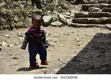 Krumjung/Nepal - April 19th 2019 : Nepali kids is walking and smiling,Nepal.
