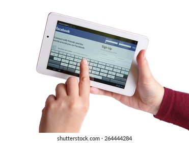 KRUSEVAC, SERBIA - MARCH 28 2015, Photo of hands holding tablet with Facebook log in page on screen, isolated on white background, Facebook is one of the most popular online social networking services