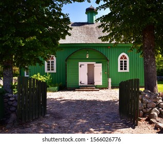 KRUSZYNIANY, PODLASKIE / POLAND - AUGUST 25 2018: View of the wooden mosque in Kruszyniany on a sunny summer day - historic monument located in north-eastern Poland - a part of Tatars trail in Poland.