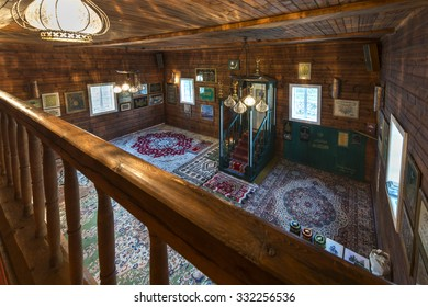 KRUSZYNIANY, POLAND - SEPTEMBER 30, 2015: Wooden tatar-mosque interior from the 18th century. Mens prayer room is separated from womens prayer room. The minbar of mosques is of an austere design.