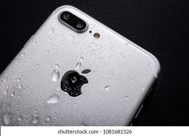 Krynica, Poland, May 02, 2018:  Close up of the Apple iPhone 7 Plus with water drops on a back side - smartphone water resistance test.