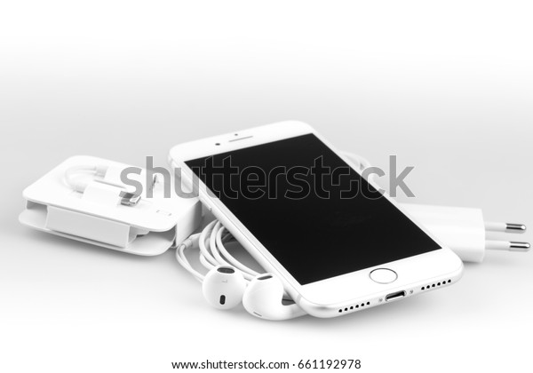 KRYNICA ZDROJ, POLAND - JUNE 13, 2017: Iphone 7  silver serie , Apple inc new smartphone with charger, earphones and adapter on white background.