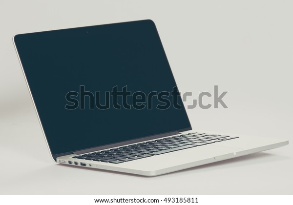 Krynica-Zdroj, POLAND - AUGUST 17, 2016: Photo of a MacBook Pro filtered instagram style. MacBook Pro Retina made by Apple Inc.