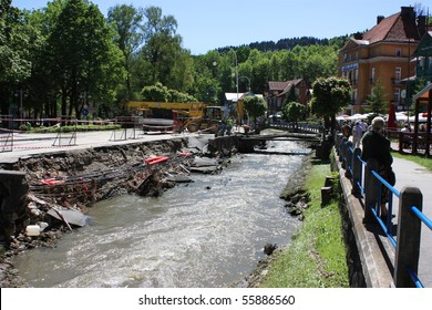 KRYNICA-ZDROJ, POLAND - JUNE 4: flood effects - road destroyed by flood June 4, 2010 in Krynica-Zdroj, Poland