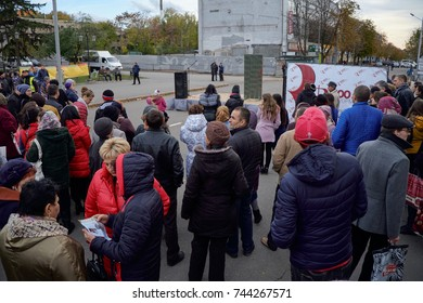 Kryvyi Rih, Ukraine - October 29, 2017:  People crowd in the street around the stage and poster during the event dedicated to Reformation 500th Anniversary