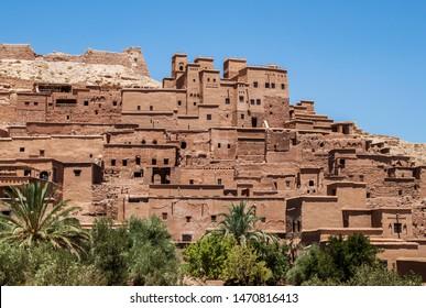 Ksar of Ait-Ben-Haddou, caravan route between the Sahara&Marrakech in the Atlas Mountains, Ouarzazate province, Morocco, Africa. Organic mud-built berber village of merchants' houses known as kasbahs.