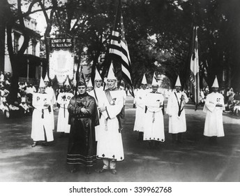 Ku Klux Klan parade in Pennsylvania, ca. 1925. Inspired by D. W. Griffith's film 'Birth of A Nation' and fueled by the entrepreneur, William Joseph Simmons, the KKK was brought back to life in the Sou - Shutterstock ID 339962768