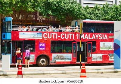 KUALA LUMPUR,MALAYSIA—Passengers boarding an open-top double-decker  Hop-On, Hop-Off city sightseeing bus at the KL Square bus stop in Kuala Lumpur, Malaysia in March 2016.