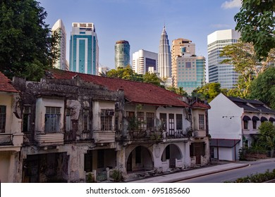Kuala Lumpur's contrasting architectural styles of colonial houses and skyscrapers, or traditional and modern