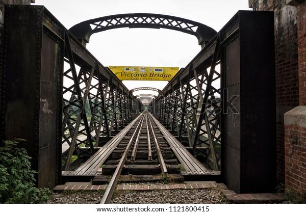 Kuala Kangsar, Malaysia - June 21, 2018: Single track railway Victoria Bridge located at Kuala Kangsar, lies beside Sungai Perak, Malaysia