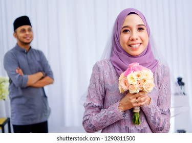 Kuala Lipis,Pahang Malaysia, 19th January 2019- Good Looking couple doing pose in front of camera during their engagement day ,Malay engagement ceremony full of culture and tradition, Selective focus.