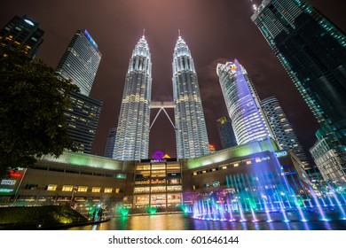 KUALA LUMPER, MALAYSIA - MARCH 03, 2017 : Petronas twin tower and musical fountain at night.