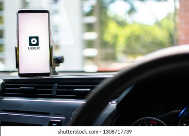 KUALA LUMPUR: 10 FEB 2019 -  Car driver using smartphone with with Uber app on screen.