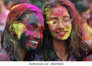 KUALA LUMPUR, 16 AUGUST 2011: women with their faces smeared with colour is seen during the Holi festival in Kuala Lumpur, Malaysia