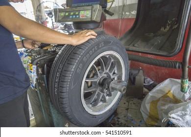 KUALA LUMPUR, 22 DEC 2016. Mechanic working in the car maintenence workshop.