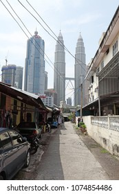 KUALA LUMPUR - APR 2, 2018: Kuala Lumpur city skyline from the Malay village enclave of Kampung Baru, KL. The area is a gazetted Malay enclave to retain village lifestyle within the city.