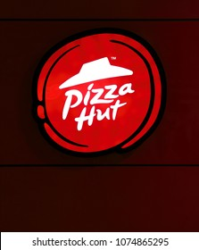KUALA LUMPUR - APR 2, 2018: Facade of Pizza Hut lighted signage in Pudu, KL. Pizza Hut is an American restaurant chain and international franchise founded in 1958.