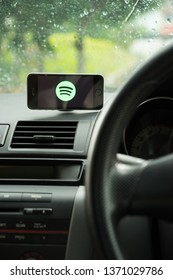KUALA LUMPUR - APRIL 16,2019: Spotify application on a smartphone inside a vehicle. Spotify is a popular commercial music streaming service.