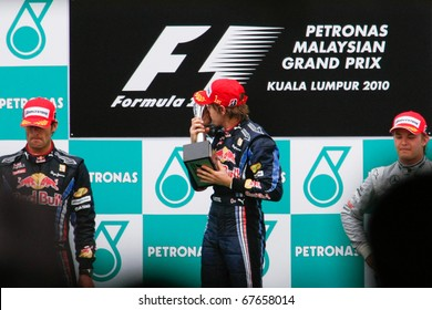 KUALA LUMPUR - APRIL 4: Race winner Sebastian Vettel of the Red Bull team kisses the trophy he won at the 2010 Petronas Malaysia GP on April 4, 2010 in Sepang. Vettel went on to become world champion.