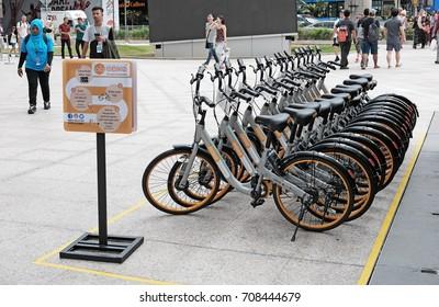 KUALA LUMPUR - AUG 16, 2017: OBike bike sharing bicycle in Jalan Bukit Bintang MRT train station, KL. The facilities is the biggest stationless bike sharing in Malaysia.