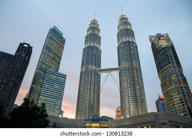 KUALA LUMPUR - AUG 29: The Petronas Towers at sunset on August 29, 2012 in Kuala Lumpur, Malaysia. 2 days before national day. Petronas are the tallest twin buildings in the world (451.9 m)